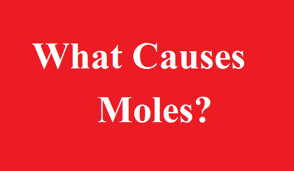 what causes moles